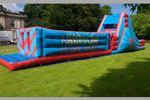 inflatable assault course with several obstacles